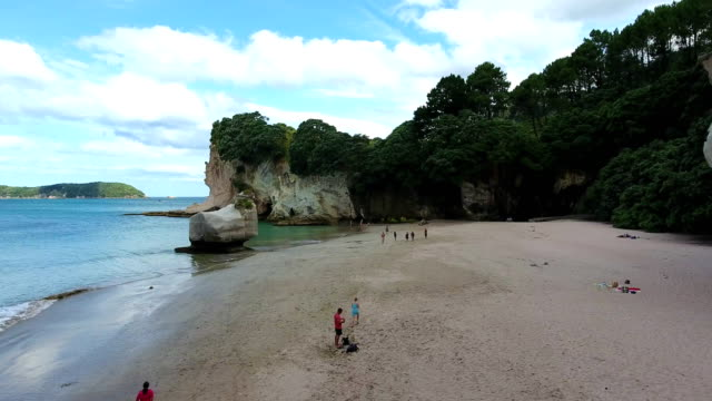 cathedral cove, cliffs, beach, rocks, sea, coromandel, new zealand - cathedral rocks stock videos & royalty-free footage