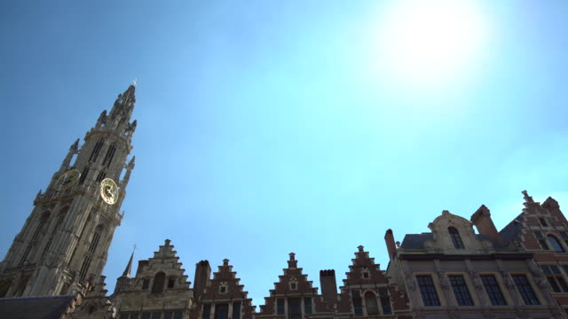 Cathedral in Antwerp with old houses, panning
