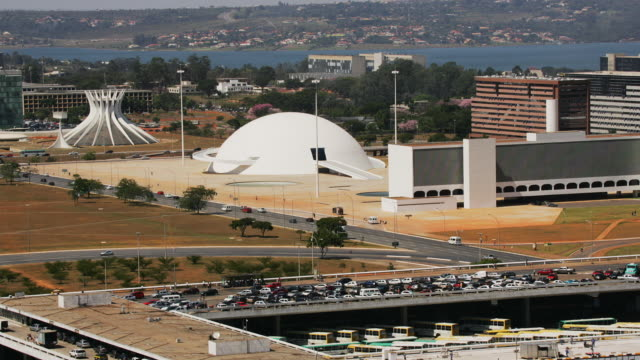 t/l, ws, ha, cathedral of brasilia and national museum, traffic on highway in foreground, brasilia, brazil - brasilia stock videos and b-roll footage