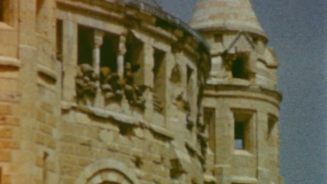 cathedral of st james in old city jerusalem with sandbags and military presence during jordanian rule / minaret with bullet holes from the battle for... - sechstagekrieg stock-videos und b-roll-filmmaterial