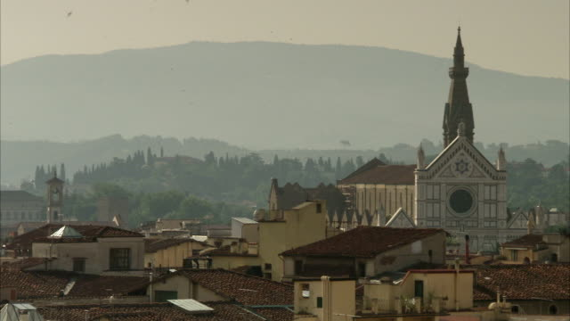 a cathedral steeple rises above the rooftops of florence, italy. available in hd. - steeple stock videos & royalty-free footage