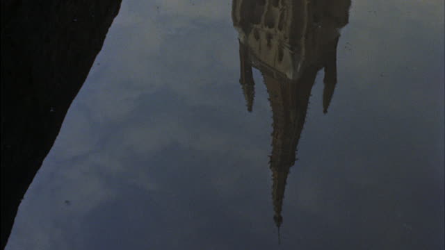 cu cathedral tower reflected on water. - cathedral stock videos & royalty-free footage