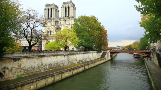 cathedrale notre dame and the seine river, paris, france - circa 14th century stock videos & royalty-free footage