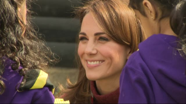 catherine duchess of cambridge crouched down chatting to young scouts at scout hq in gilwell park epping forest - キャサリン妃点の映像素材/bロール