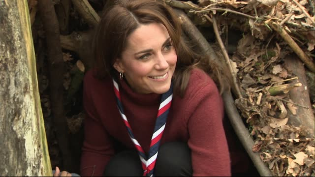 catherine duchess of cambridge crouches in den and asks to be helped out during visit to scouts hq at gilwell park epping forest - キャサリン妃点の映像素材/bロール