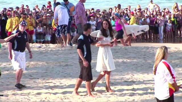 catherine, duchess of cambridge talks to children on manly beach on april 18, 2014 in sydney, australia. the duke and duchess of cambridge are on a... - macho stock videos & royalty-free footage