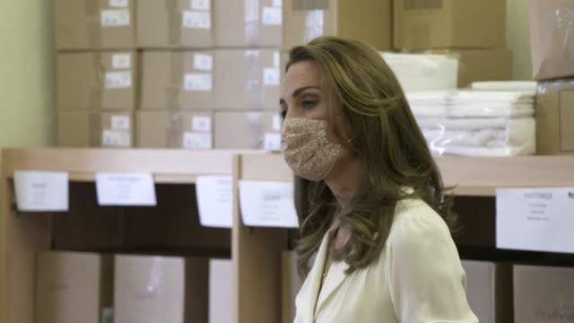 catherine duchess of cambridge wearing latex gloves and face mask due to coronavirus pandemic on visit to baby basics uk in sheffield - glove stock videos & royalty-free footage
