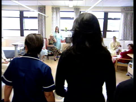 catherine zeta-jones visits maternity hospital; wales swansea int/itn 00.43 gv catherine zeta-jones along hospital corridor with others & into... - catherine zeta jones video stock e b–roll