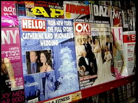 vídeos y material grabado en eventos de stock de catherine zeta-jones/michael douglas privacy row; lib itn hello! and ok! magazines with pictures of zeta jones wedding on front - revista publicación