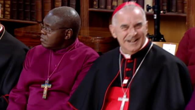 vidéos et rushes de catholic cardinal criticises government plans for gay marriage; lib london: lambeth palace: int cardinal keith o'brien sitting next to dr john sentamu - lambeth