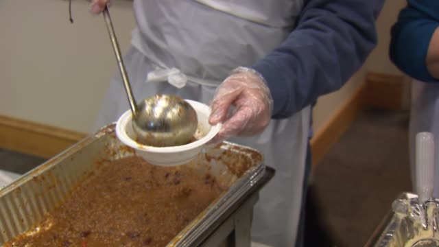wgn catholic charities served meal to some 300 homeless men and women on christmas eve and christmas day food being put into bowl at homeless shelter... - soup kitchen stock videos & royalty-free footage