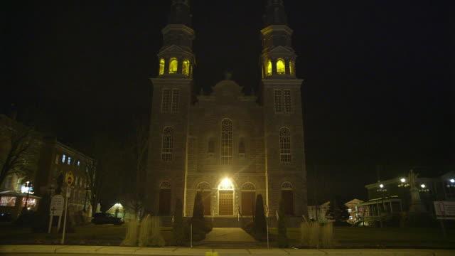 ws of catholic church at night - church stock videos & royalty-free footage