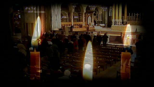 catholic church in gay adoption row with government blair gives agencies until 2008 to comply graphicised sequence of close up of candle flames as... - religious service stock videos & royalty-free footage