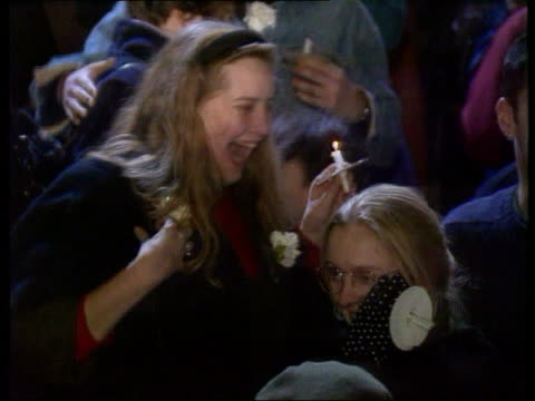 stockvideo's en b-roll-footage met catholic church nightengland london westminster tms crowd celebrating vote to allow ordination of women tcms people hugging tcms happy woman tcms two... - katholicisme