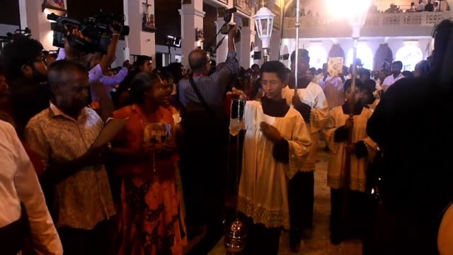 catholic devotees attend a mass at newly reconsecrated st anthony's shrine in colombo sri lanka - religious mass stock videos & royalty-free footage