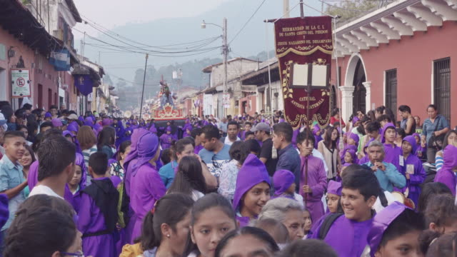 catholic parade at antigua guatemala during lent / easter celebration. people dressed in purple costume - guatemala stock videos & royalty-free footage