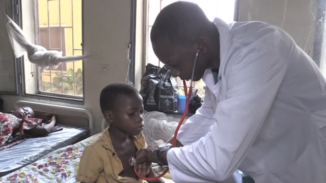 a catholic priest who set up a heath centre to tackle sickle cell anaemia in the democratic republic of congo died last november - sickle stock videos & royalty-free footage