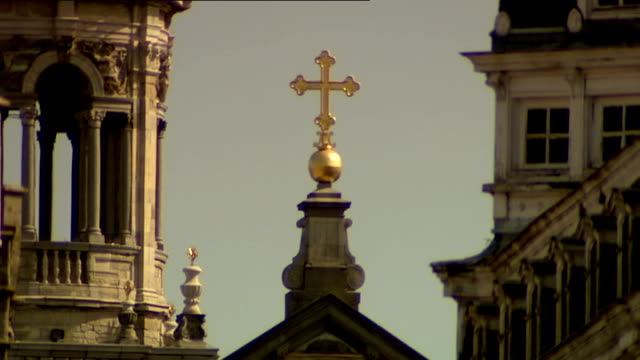 catholic priests abused victims over course of decades ext golden cross on pedestal at apex of roof baroque hurch buildings - baroque点の映像素材/bロール