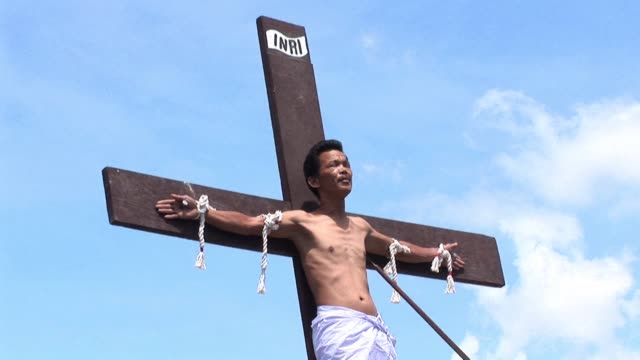 Catholic zealots in the Philippines re enact the last hours of Jesus Christ on Good Friday whipping their backs and nailing themselves to crosses in...