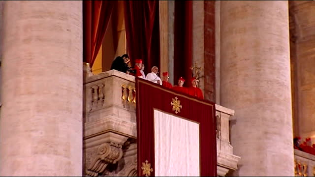 new pope elected pope francis low angle shot pope francis on balcony pull out to reporter reporter to camera - elezione video stock e b–roll