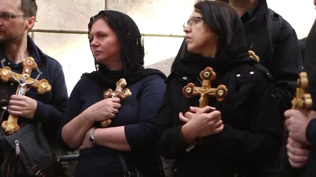 catholics and orthodox christians celebrated good friday in jerusalem by participating in a procession on the via dolorosa - via dolorosa stock videos & royalty-free footage