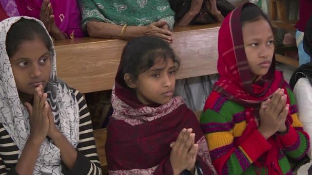vídeos y material grabado en eventos de stock de catholics in bangladesh attend church ahead of the pope's visit on thursday - catolicismo