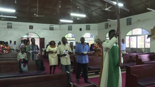 Catholics in Sierra Leone pay tribute to victims of the deadly floods and mudslide at a mass at St Paul's church in the area of Regent where the...