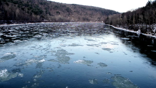 NY Catskill Mountains Delaware River Water Flowing with Winter Ice