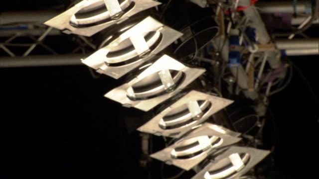 td pan cu catwalk lights hanging above delivery man wearing matching cap and uniform / london, england, uk - この撮影のクリップをもっと見る 1064点の映像素材/bロール