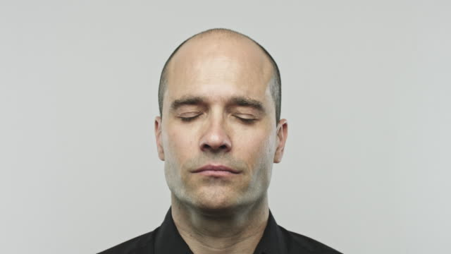 Caucasian adult man closing eyes