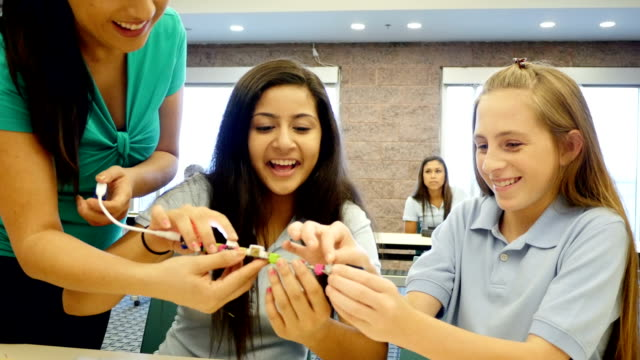 caucasian and middle eastern junior high students test electronic switches in science and technology class - female high school student stock videos and b-roll footage