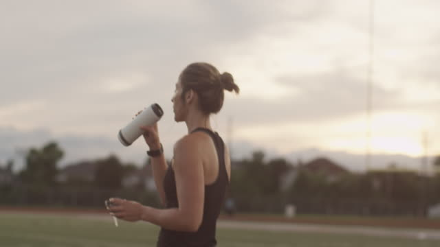 caucasian athlete drinking water after workout - focus on foreground stock videos & royalty-free footage