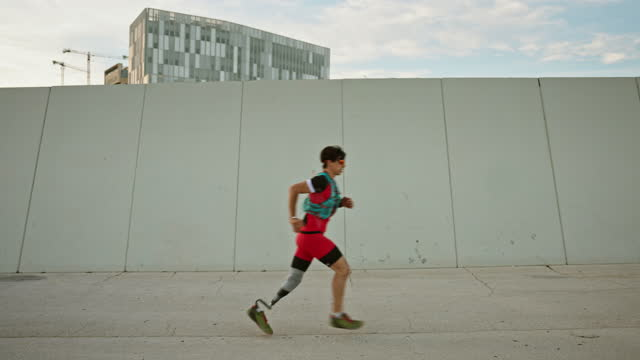caucasian athlete with disability running in late afternoon - moving past stock videos & royalty-free footage