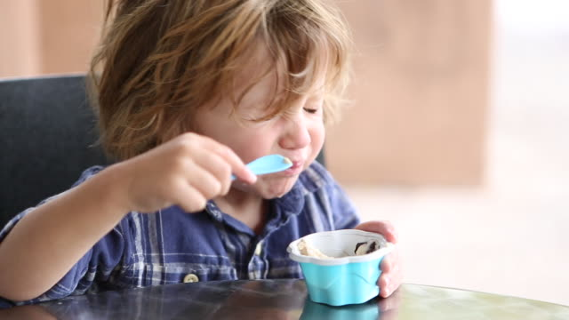 caucasian boy eating ice cream - cold temperature stock videos & royalty-free footage