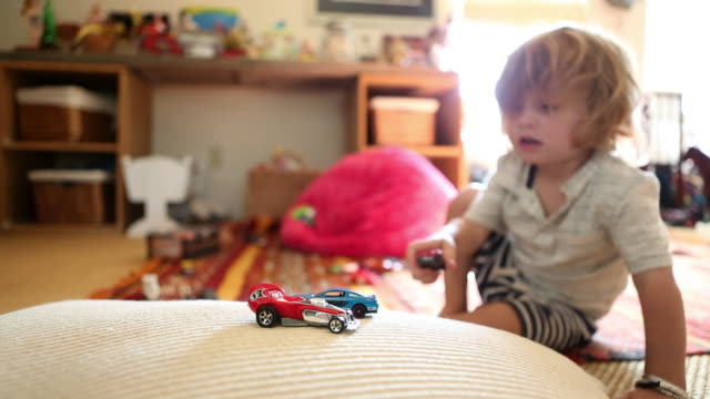 caucasian boy playing with toy car - toy stock videos & royalty-free footage