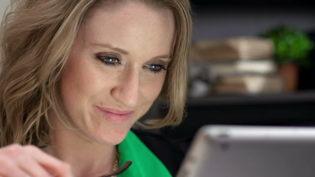 caucasian business woman uses tablet - reading glasses stock videos & royalty-free footage