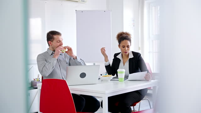 caucasian businessman eating burger and dirts shirt with ketchup in an office - shirt stock videos & royalty-free footage