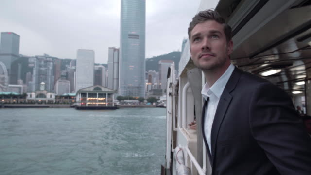 WS TS Caucasian businessman riding the Star Ferry in Hong Kong