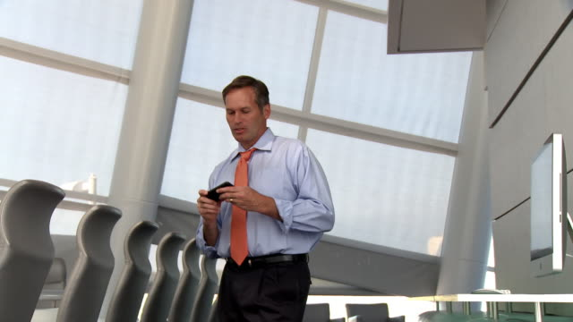 Caucasian businessman talking and texting on cell phone