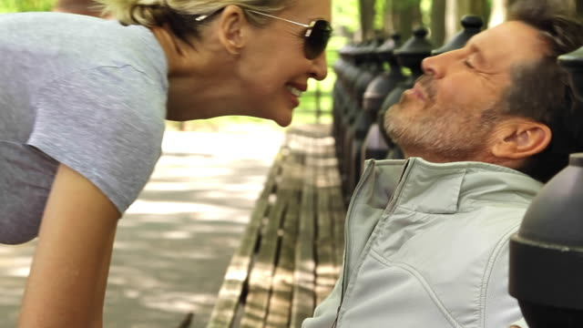 Caucasian couple sitting in park