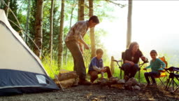Caucasian family enjoying camping vacation together America forest