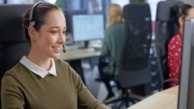 caucasian female call center agent talking with a customer - customer focused stock videos & royalty-free footage