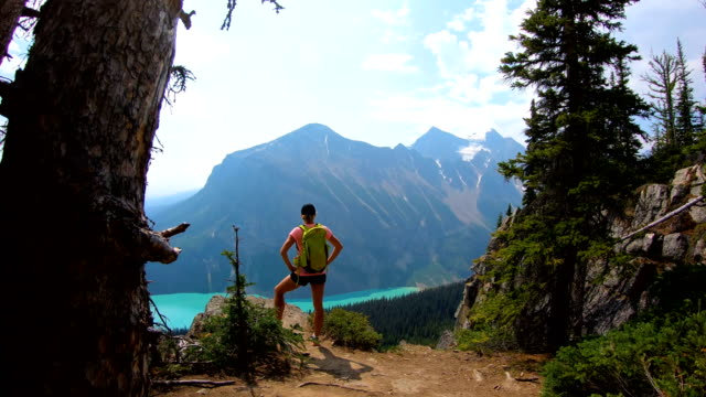 POV Caucasian female hiking in mountain countryside Canada