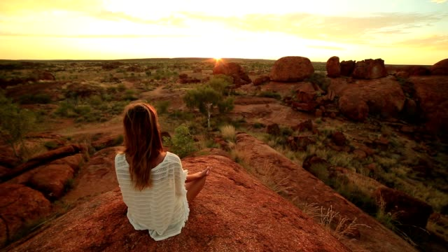 caucasian female meditating at sunrise - outback stock videos & royalty-free footage