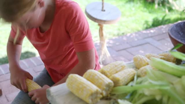 caucasian girl shucking corn - husking stock videos & royalty-free footage