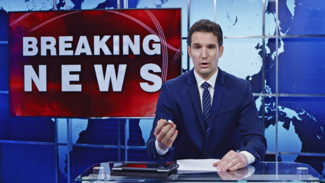 ld caucasian male anchor presenting breaking news - breaking news stock videos and b-roll footage
