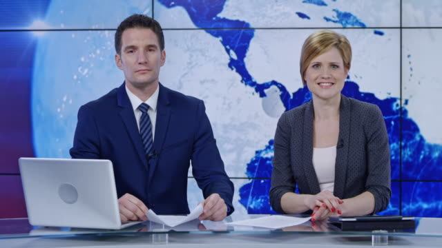 ld caucasian male and female anchor presenting the news - media interview stock videos and b-roll footage
