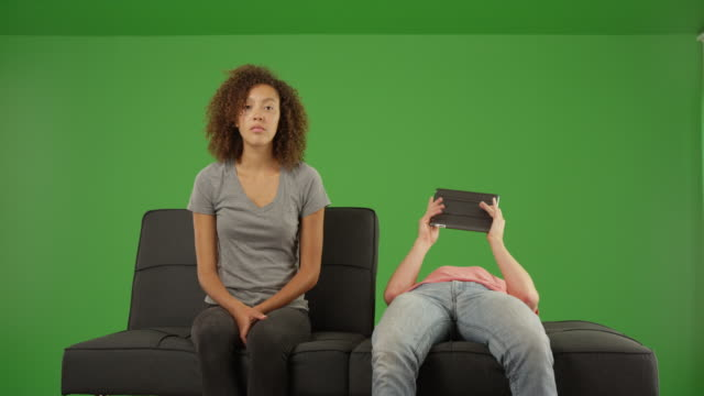 caucasian male using tablet computer ignoring girlfriend on green screen - psychiatrist's couch stock videos and b-roll footage