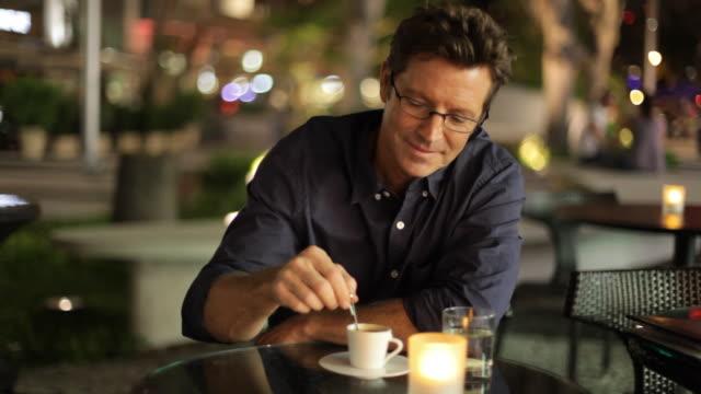 Caucasian man drinking espresso