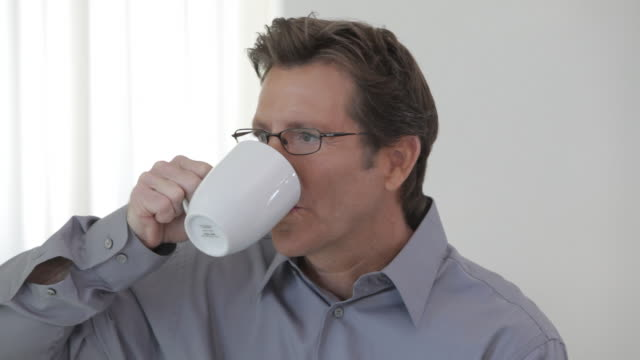 Caucasian man with coffee cup